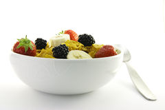 Cornflakes and Fruit in a White Bowl with Spoon Stock Photography