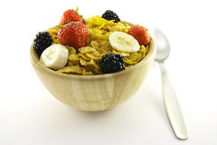 Cornflakes and Fruit in a Wooden Bowl with Spoon Royalty Free Stock Photo