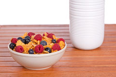 Cornflakes with fruits and milk bottle Stock Photo