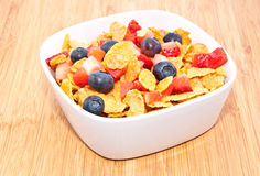 Cornflakes with fruits on wood Royalty Free Stock Photo