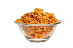 Cornflakes in glass bowl. Cornflakes in glass bowl isolated over white background Stock Images