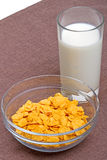 Cornflakes and glass of milk Stock Images