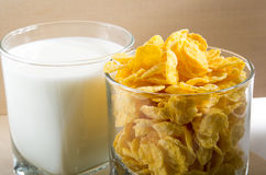 Cornflakes and glass of milk for cooking. Close up Stock Photo