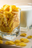 Cornflakes and glass of milk for cooking. Corn flakes and glass of milk for cooking closeup Stock Photography