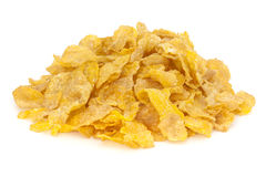 Cornflakes Heap. Heap of cornflakes isolated on white, front to back focus royalty free stock photography