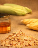 Cornflakes with honey. Conflakes cereal with honey and corn cobs Stock Photo