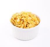 Cornflakes i porslinbunke Arkivfoton