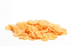 Cornflakes isolated on white background. A pile of cornflakes isolated on white background Stock Photo