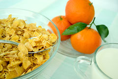 Cornflakes and mandarins Stock Photos