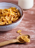 Cornflakes with milk. On board Stock Image