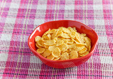 Cornflakes with milk in bowl Stock Photography
