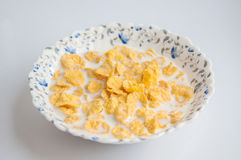 Cornflakes with milk. In bowl Royalty Free Stock Photography