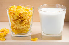 Cornflakes and milk in glass cups Stock Images