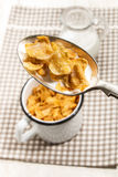Cornflakes with milk on a spoon Stock Photography