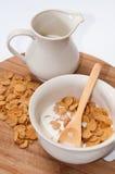 Cornflakes with milk in the white bowl Stock Photos