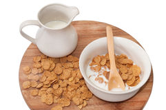 Cornflakes with milk in the white bowl Royalty Free Stock Photos