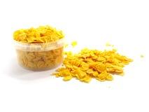 Cornflakes op een witte achtergrond worden geïsoleerd die Stock Afbeelding