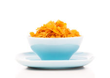 Cornflakes in porcelain bowl Royalty Free Stock Image