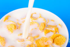 Cornflakes and pouring milk Stock Photography