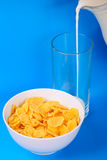 Cornflakes and pouring milk Royalty Free Stock Photo