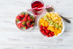 Cornflakes and Rainbow  fruit salad , strawberry ,  juice for br Stock Photography