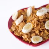 Cornflakes & sliced banana. On a heart shaped plate - healthy Royalty Free Stock Images