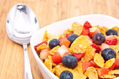 Cornflakes with Strawberries and Blueberries Royalty Free Stock Images