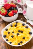 Cornflakes with strawberries and blueberries Stock Images