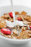 Cornflakes with strawberry Stock Images
