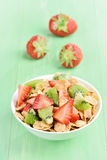Cornflakes with strawberry and kiwi slices Royalty Free Stock Photos