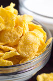 Cornflakes in a transparent bowl closeup Royalty Free Stock Photo