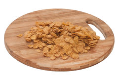 Cornflakes on the wooden board Stock Photos