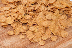 Cornflakes on the wooden board Stock Photo