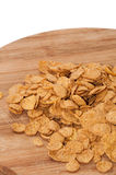 Cornflakes on the wooden board Royalty Free Stock Image