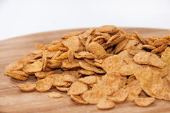 Cornflakes on the wooden board Royalty Free Stock Images