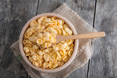 Cornflakes in a wooden bowl Royalty Free Stock Photography