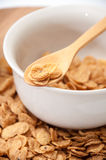 Cornflakes on the wooden spoon Royalty Free Stock Photos