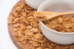 Cornflakes on the wooden spoon Royalty Free Stock Images