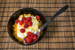 Cornflakes with yogurt and raspberries. Nutritious and very tasty fresh summer breakfast Stock Photos