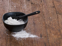 Cornflour in bowl, used for thickening sauces etc. Royalty Free Stock Image
