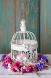 Cornflower wreath and vintage birdcage. Home decoration Royalty Free Stock Images