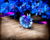 Cornflowers over wood Stock Photos