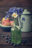 Cornflowers in vintage bottle Stock Photo
