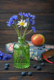 Cornflowers in vintage bottle Stock Photography