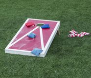 Red and white cornhole game stock photography