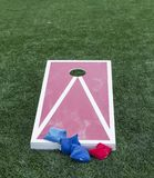 Cornhole game with bean bags ready to be used Stock Photography