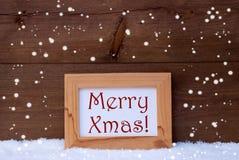 Cornice con natale allegro del testo, neve, fiocchi di neve Fotografia Stock Libera da Diritti