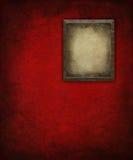 Cornice di Grunge sulla parete rossa Fotografia Stock