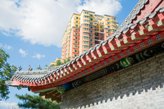 Cornice of traditional chinese roof and contemporary building. Royalty Free Stock Photo