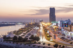 Corniche in Ras al Khaimah at dusk. RAS AL KHAIMAH, UAE - NOV 30, 2016: Ras al Khaimah creek and corniche illuminated at night. United Arab Emirates, Middle East Stock Photography